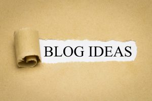 """Image of a piece of paper, with a small portion of the middle torn away and rolled up with the words """"Blog Ideas"""" showing up behind the paper. My blog about neurodiversity will assist those who are ASD at any point on the autism spectrum in Silicon Valley, the Bay Area and beyond."""