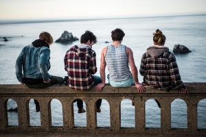 Picture of autistic teen boys with friends near water. Autism social skills and support group in Palo Alto, CA near Bay Area available.