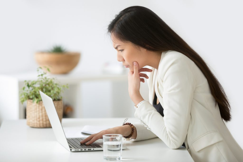 Woman hyperfocusing on a project on her computer | Autism Resources in Palo Alto, CA for Social Skills Classes and more during COVID | Open Doors Therapy | 94306