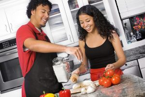 Young autistic couple cooking dinner. Acts of service is one of the love languages. Dating for Neurodiverse Adults is challenging but Autism therapy in Palo Alto, CA 94306 at Open Doors Therapy with Dr. Tasha Oswald