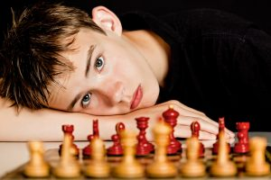Twice-exceptional teenage boy excels at chess, but struggles with social skills. He attends autism social skills group at open doors therapy in Palo Alto at Open Doors Therapy 94306