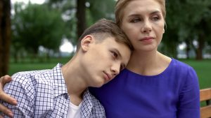 teen with autism and his mom. Learn more about autism and loneliness amongst autistic teens at Open Doors therapy