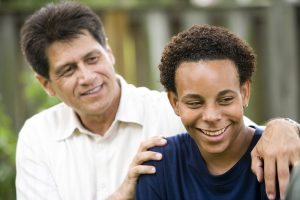 father looking at son. They get autism family therapy in California at Open Doors Therapy 94306