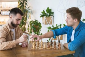 two men play chess representing friendship and learning how to deal with conflict on the autism spectrum from online autism therapy in California