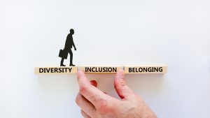 photo of a person walking along blogs that say diversity, inclusion, and belonging. This represents autism acceptance and autism therapy in California with an autism therapist at Open Doors Therapy