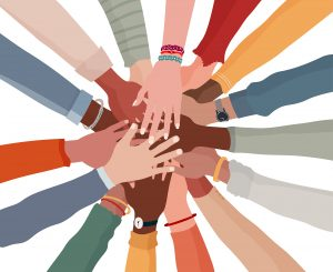 image of hands in a circle representing autism acceptance. Get autism therapy in California at Open Doors Therapy 94306